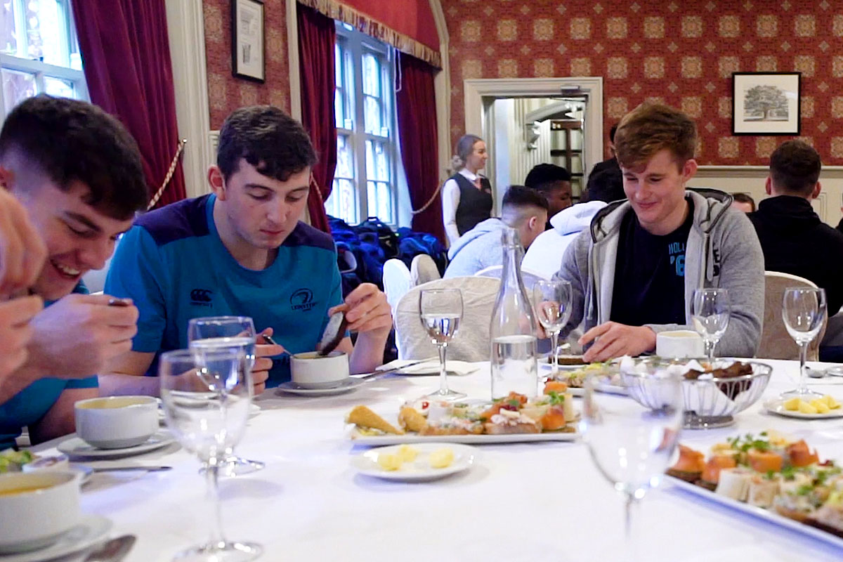 rugby players eating lunch